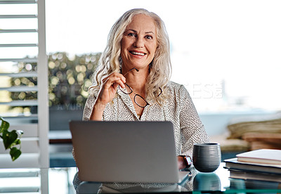 Buy stock photo Cropped portrait of an attractive senior businesswoman smiling while working from home