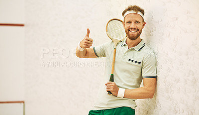 Buy stock photo Shot of a confident young man showing thumbs up at a squash court