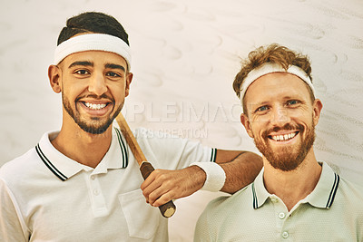 Buy stock photo Shot of two confident young men standing together at a squash court