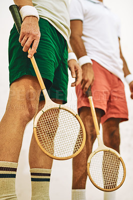 Buy stock photo Cropped shot of two men holding their racquets at a squash court