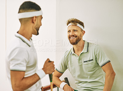 Buy stock photo Shot of two young men chatting after a game of squash on the viewing gallery