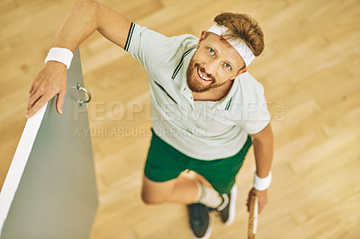 Buy stock photo High angle shot of a young man standing at the entrance of a squash court
