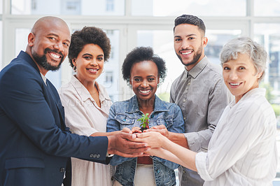 Buy stock photo Portrait of a group of businesspeople holding a plant growing in soil