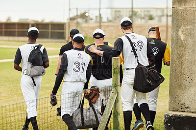 Buy stock photo Rearview shot of a team of young baseball players walking together on the pitch outdoors