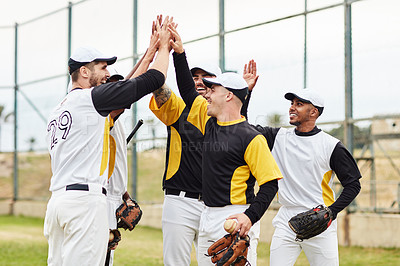 Buy stock photo Cropped shot of a team of young baseball players joining hands together for a high five during a game outdoors