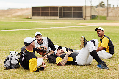 Buy stock photo Full length shot of a group of young baseball player lying down and relaxing together on the pitch outdoors