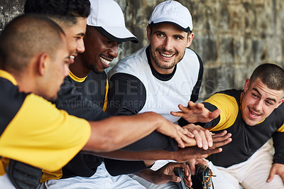 Buy stock photo Cropped shot of a team of young baseball players joining their hands together in a huddle during a game outdoors