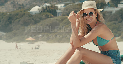 Buy stock photo Portrait of an attractive young woman enjoying herself at the beach