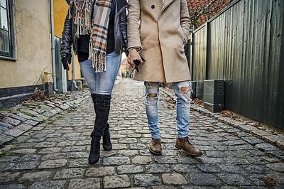 Buy stock photo Cropped shot of an unrecognizable and stylish couple traveling together together in a foreign town