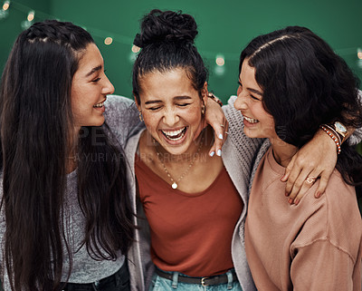 Buy stock photo Shot of three happy young sisters embracing at a cafe