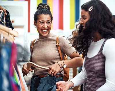 Buy stock photo Cropped shot of two attractive sisters bonding together during a shopping spree in the city