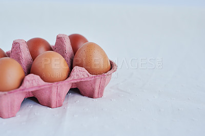 Buy stock photo Studio shot of chicken eggs in a carton against a white background