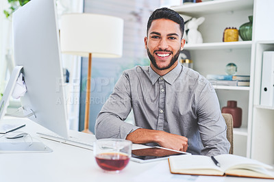 Buy stock photo Portrait of a young businessman working on a computer in an office