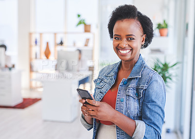 Buy stock photo Portrait of a young businesswoman using a cellphone in an office