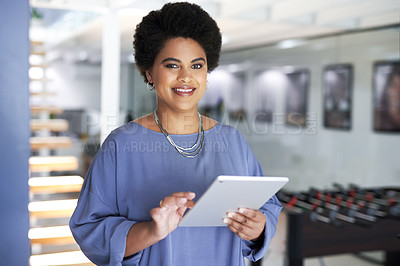 Buy stock photo Portrait of an attractive young businesswoman using a digital tablet inside her office