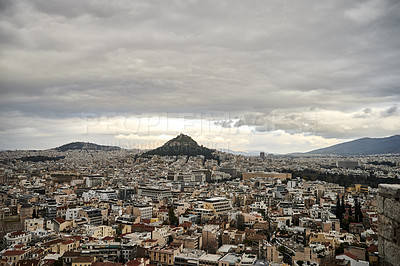 Buy stock photo Cropped shot of an overcast sky settling over the city of Athens during the day