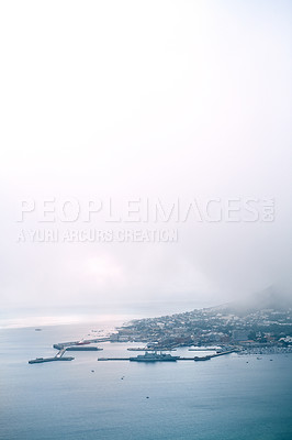Buy stock photo Cropped shot of a busy coastal village on a mountain side during the day