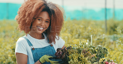 Buy stock photo Cropped portrait of an attractive young female farmer smiling while working in a crop field