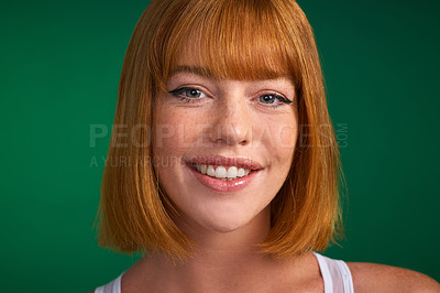 Buy stock photo Cropped portrait of an attractive young sportswoman standing alone against a green background in the studio