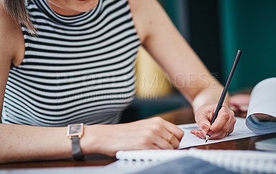 Buy stock photo Cropped shot of an unrecognizable businesswoman working on paperwork in her office