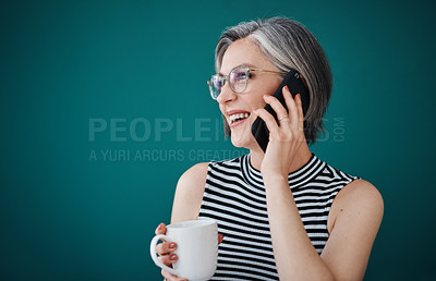 Buy stock photo Shot of a businesswoman having coffee while talking on her cellphone in her office