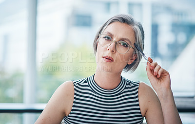 Buy stock photo Cropped shot of a mature businesswoman sitting at her desk