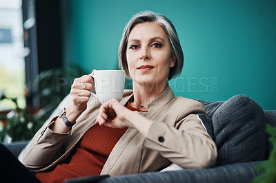 Buy stock photo Cropped portrait of an attractive mature businesswoman sitting alone and enjoying a cup of coffee in her home office