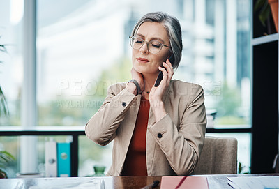 Buy stock photo Cropped shot of an attractive mature businesswoman sitting and suffering from a sore neck while in her home office