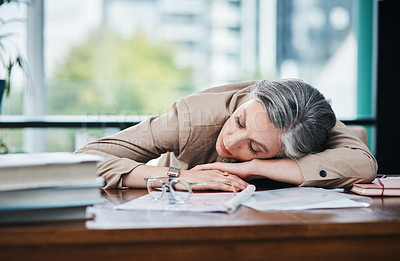 Buy stock photo Cropped shot of an attractive mature businesswoman asleep at her desk in her home office
