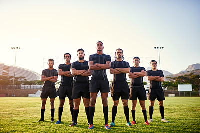 Buy stock photo Full length portrait of a diverse group of sportsmen standing together before playing rugby during the day
