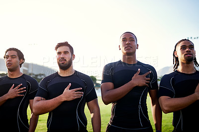 Buy stock photo Cropped shot of a diverse group of sportsmen standing together and singing their national anthem before playing rugby