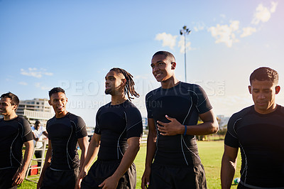 Buy stock photo Cropped shot of a diverse group of sportsmen standing together before playing rugby during the day