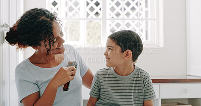 Buy stock photo Cropped shot of a mother brushing her adorable young son's hair at home