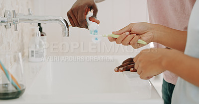 Buy stock photo Cropped shot of unrecognizable couple getting ready to brush their teeth inside their bathroom at home
