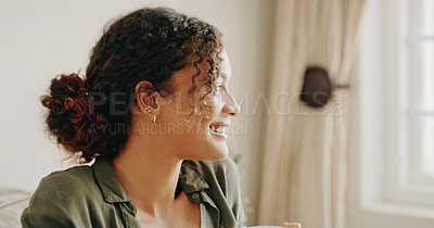 Buy stock photo Cropped shot of an attractive young woman feeling thoughtful while looking out the window inside her house