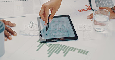 Buy stock photo Cropped shot of businesspeople using a digital tablet during a meeting in a modern office