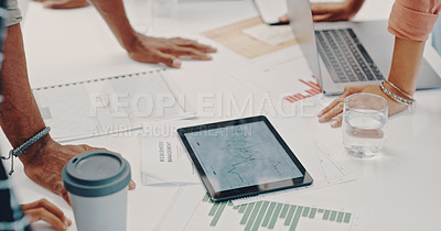 Buy stock photo Cropped shot of a group of businesspeople using a digital tablet during a meeting in a modern office