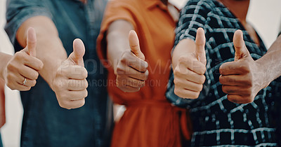 Buy stock photo Cropped shot of a group of businesspeople showing thumbs up while standing together