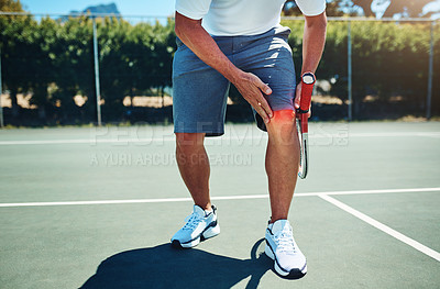 Buy stock photo Cropped shot of an unrecognizable sportsman suffering from a knee injury while playing tennis alone