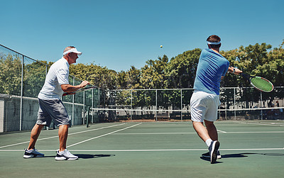 Buy stock photo Full length shot of a handsome mature sportsman coaching a fellow team-mate during a tennis training session