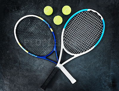 Buy stock photo High angle shot of tennis essentials placed on top of a dark background inside of a studio