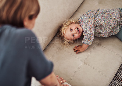 Buy stock photo Cropped portrait of an adorable little girl bonding with her mother during a day at home