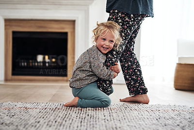 Buy stock photo Cropped shot of an adorable little girl bonding with her mother during a day at home