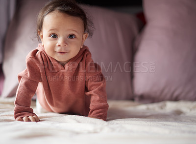 Buy stock photo Full length portrait of an adorable baby boy crawling on a bed at home