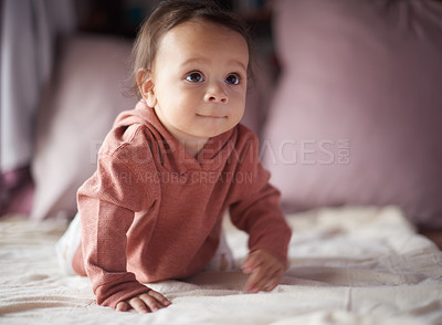 Buy stock photo Cropped shot of an adorable baby boy crawling on a bed at home