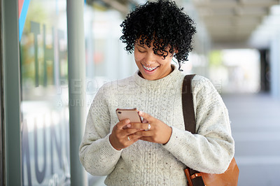 Buy stock photo Shot of a student using a cellphone while walking around campus
