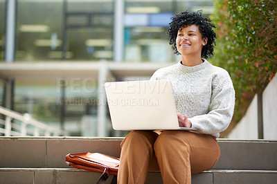 Buy stock photo Shot of a student using a laptop outside at campus