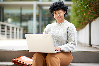 Buy stock photo Portrait of a student using a laptop outside at campus