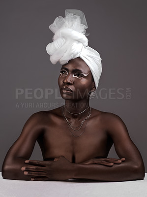 Buy stock photo Studio shot of an attractive young woman posing in traditional African attire against a grey background