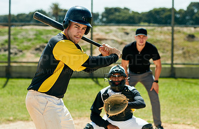 Buy stock photo Cropped shot of a handsome young baseball player preparing to bat a ball during a game on the field